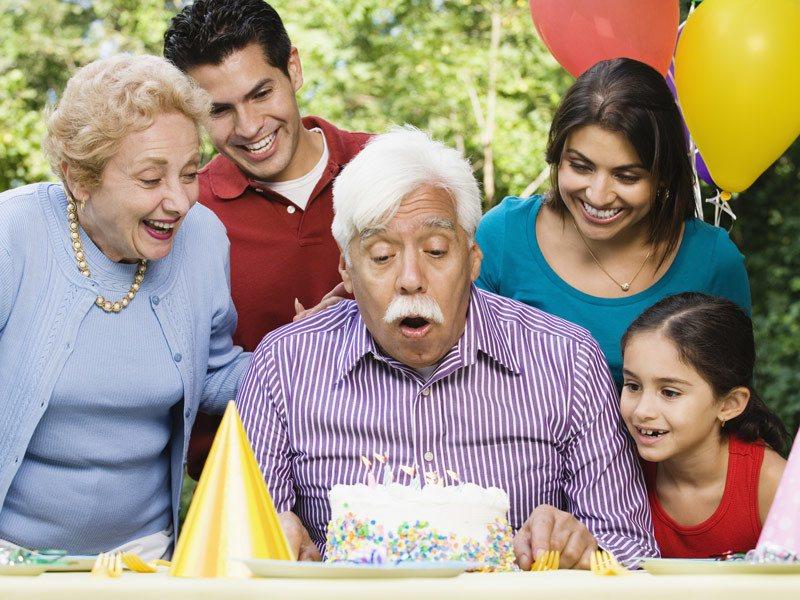 Multi generation family celebrating birthday.