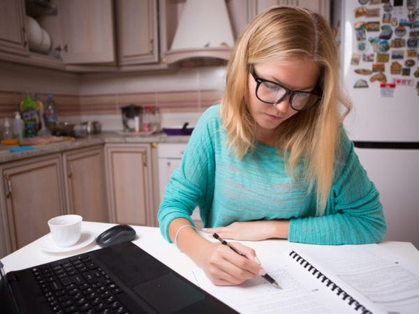 Woman working on tax forms.