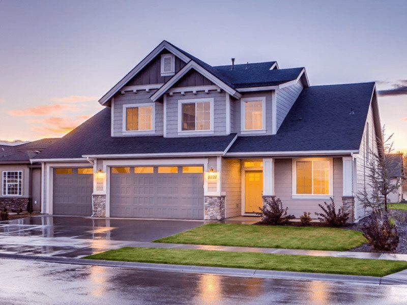 Home exterior at sunset after a rain shower.