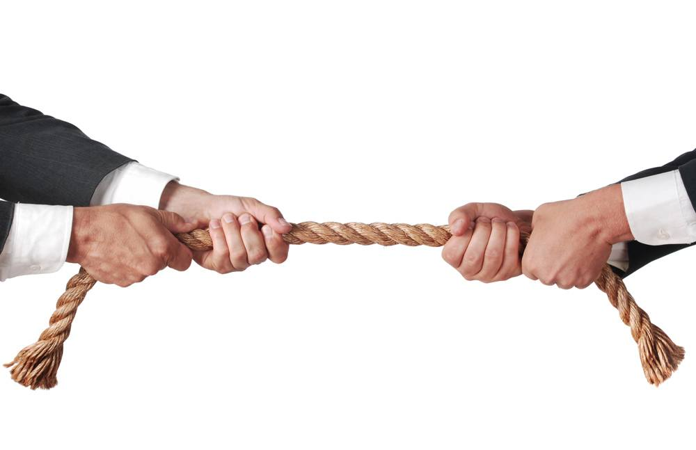 Tug of war between two businessmen